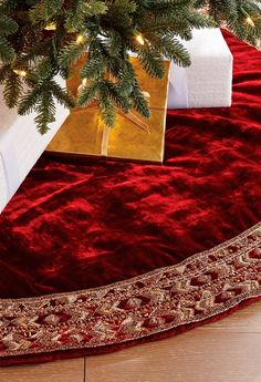 This deep burgundy and metallic gold tree skirt features more than 100,000 individually hand-sewn beads and crystals on polyester velvet fabric. Each will provide quite a regal touch to your holiday decor.