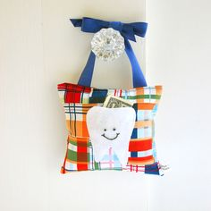 Boys Tooth Fairy Pillow in Navy Blue and Tangerine Orange Nautical Madras Print. $18.00, via Etsy.