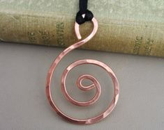 We hand forged 14 gauge copper to make these simple bold big swirling hoop earrings. The ear wire is 20 gauge sterling silver. If you would