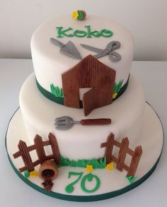 Gardening cake, shed, fence and gardening tools cake out of fondant.