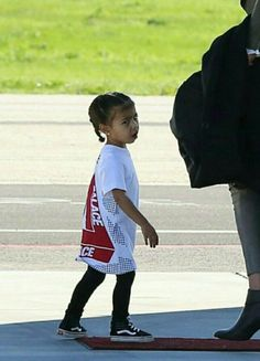 """teamkanyedaily: """"North rocking her Palace t-shirt and Vans at the airport in LA. Jenner Kids, Kardashian Jenner, Shades Of Black, North West, Little Ones, Black Women, Hipster, Celebrities, Hats"""
