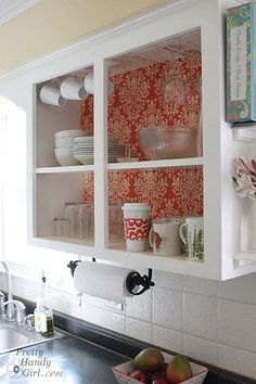 (papier rouge) I can see doing this with a few of my cabinets using the fine papers at Paper Source. I like how open the space looks w/o the cabinet doors!