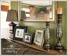 put a narrow table behind a couch that is up against the wall then accessorize - mirror above couch
