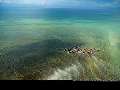 Yann Arthus-Bertrand - Village on stilts in Tongkil, Samales Islands, Philippines