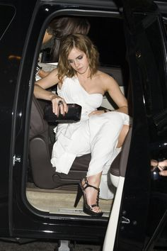 Emma Watson making a dignified exit from her car.