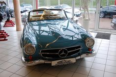 A 1967 Mercedes Benz 230 SL at Auto Salon Singen, Germany.  Love this color!!!!