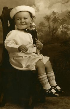 From my modest collection of vintage photos of children.
