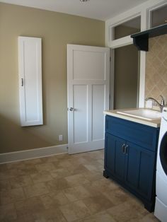 Marvelous wall mounted ironing board in Laundry Room Farmhouse with Craftsman Style Door next to Ironing Board Cabinet alongside Shaker Doors and Colored Interior Doors Cloakroom Toilet Small, Farmhouse Interior Doors, Utility Room Designs, Craftsman Style Doors, Laundry Room Cabinets, Cupboards, Door Design Interior, Colorful Interiors, Basement