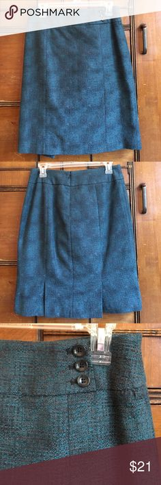 """Ann Taylor Blue and Gray Blend Pencil Skirt Thick, quality fabric perfect for work! EUC; worn only twice. Darling three button detail on the front near the waist and a double-slit in the back.  Cotton shelf with polyester lining. Dry clean only. No rips, snags, tears, or stains. Waist at smallest part: 14.5"""" Length: 21.25"""" Ann Taylor Skirts Pencil"""