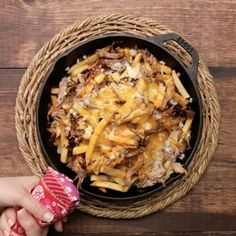 BBQ Pulled Pork Fries ⠀ *Save this recipe on our app! Link in bio.⠀ INGREDIENTS:⠀ 2–3 lbs pork shoulder⠀ Salt and pepper⠀ 1 cup root beer⠀ 2 cups barbecue sauce⠀ Large bag of frozen french fries⠀ ⅓ cup white onion, minced⠀ 1 cup shredded pepper jack cheese⠀ 1 cup shredded cheddar cheese⠀ Chopped scallions, sour cream, extra barbecue sauce for garnish⠀ STEPS:⠀ Season pork shoulder with salt and pepper.⠀ Heat a large heavy-bottom sauce pot over high heat and sear pork on all sides until golden…