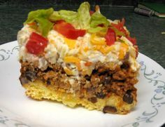 Healthy & Low Calorie: Taco Corn Bread Casserole  Taco Corn Bread Casserole    1 package (8 1/2 oz) corn bread/muffin mix  1 egg  1/3 cup milk  3 cups cooked taco seasoned meat  1 can black beans  1 cup (8 oz) sour cream, light  1 cup colby jack, cheddar or mexican cheese, shredded and divided  1/2 cup onion, chopped  1 medium tomato, chopped  1 cup shredded lettuce