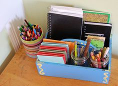 encourage writing - blank books display - I'm doing this with my wicker silverware caddy The Boy found last week at a yard sale!