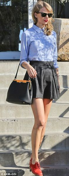 High-waisted black pleated skirt, blue button down shirt, and red oxfords