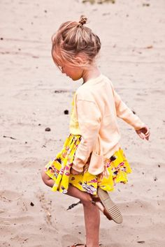 if i ever have a daughter i'm assuming this would be her with the blonde hair and the beach. how cute is her hair?