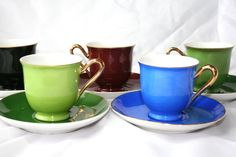 Time for tea... Adorable rare Vintage Multi Colored Footed Tea Cups and Saucers - set of 5- from Julius Dietl at El Bogen from Czechoslovakia. Julius Dietl only owned the factory from 1934-1940. These are very unusual with their colors. They have gold gild edging with two types of green, one blue, one brown and one black. They are stamped on the bottom.  They are in good vintage condition. There are no cracks or crazing, but they do have some gold gild wear. The blue cup has a tiny paint…