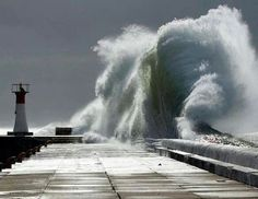 Wave crashing on a pier