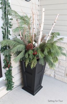 pictures of urn christmas fillers | This Top That created a gorgeous Red and Green Entryway for Christmas ...