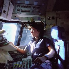 Astronaut Sally K. Ride(May 26, 1951 - July 23, 2012), mission specialist on STS-7, monitors control panels from the pilot's chair on the Flight Deck. Floating in front of her is a flight procedures notebook.