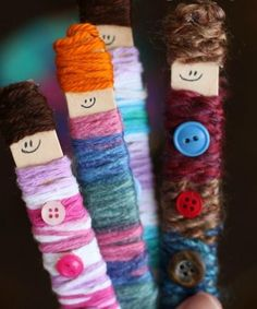 Use up some scrap yarn and popsicle sticks to make some of the cutest dolls!