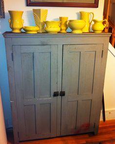Yellow McCoy & a gray farmhouse cabinet top... how cute!