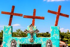 Crosses atop at colorful grave at a cemetery in the tiny Mayan town of Dzemul, Yucatan, Mexico.