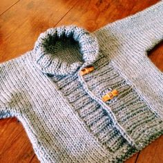 Knitting is good for the soul. Pattern from Ravelry (ribbed baby jacket).