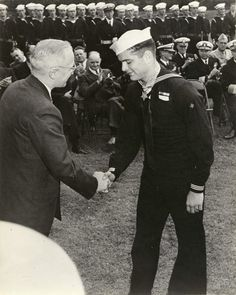 President Harry S. Truman awards the Congressional Medal of Honor to Hospitalman Apprentice 1st Class Robert Bush. During World War II corpsmen received seven medals of honor for their actions at Iwo Jima and Okinawa. A Navy decision not to award this medal to corpsmen prior to those World War II campaigns precluded many equally deserving young men from receiving the nation's highest honor.