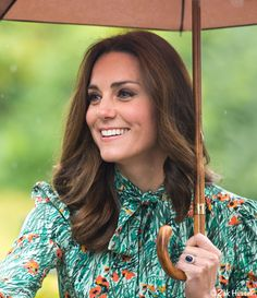 The Duchess of Cambridge, formerly Kate Middleton, wore Prada for the event Remembering Diana, Princess of Wales, at Kensington Gardens. Kate's dress by Prada today for visit to the White Garden in memory of Diana. Kate is carrying a Brigg umbrella from British heritage brand Swaine Adeney Brigg.