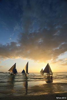 sailing during sunset - Boracay, Philippines