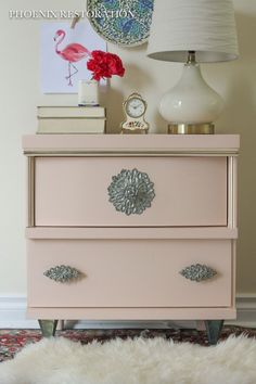 Give vintage furniture new life with a timeless, classic paint color. Rose is all the rage right now, and we're in love with this beautiful hue Christina chose for her adorable nightstand. Can you guess it? If you said, Blushing SW 6617, you're right!