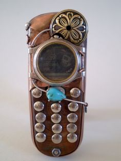 The turquoise caught my attention on this cell phone, but the round screen and flowered medalion complete the look.