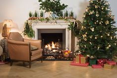 Living Room : Sweet Cristmas Tree With Brown Wooden Laminate Flooring Also Soft Brown Arm Chairs And White Wall Fireplace Besides Table Cristmas Lamp Enjoying Christmas Festivities In Living Room Using Christmas Lights To Decorate Living Room. Neutral Colour Harmoniously. Pinterest Christmas Living Room Ideas.