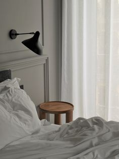 Foresta - The Tótem Residence. Slow moments in bed, Simple interior design, Copán Side Table designed by Rebecca Goddard, Calmness interiors, Minimal bedroom style and soft lighting, Minimal scandinavian bedroom, Slow Mornings, Simple neutral aesthetic, Danish interior design pieces, White bedroom, Warm interior Style, Wooden Side Table, Old european apartment, Interior architecture, Beautiful molding, Natural decor, Warm minimalism, Slow and Ethical Brand, Sustainable furniture