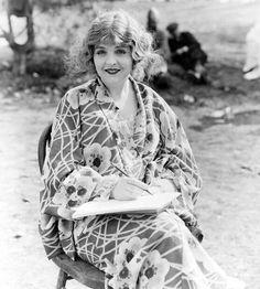 """Enid Bennett taking a break from filming """"The Sea Hawk"""" - 1924"""