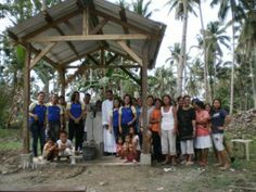 The local priest blesses the new well at Barangay Concepcion, Philippines.