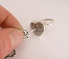 Locking Heart Ring with Seperate Key in Sterling Silver
