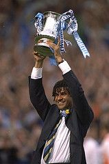 17 May 1997: Jubilant Chelsea manager, Ruud Gullit, holds the FA Cup high after the FA Cup Final against Middlesbrough at Wembley Stadium. Chelsea won 2-0.