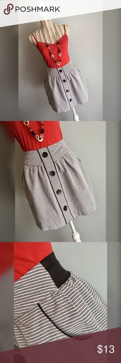 """🎀Love Notes Skirt🎀 Grey and white striped skirt with button accents by Love Notes. Tag says size Medium but it's very small so I'm marking it as an Extra Small. Please check measurements. Elastic waistband in the back. Side pockets. Waist 25"""" lying flat, stretches to 28"""". Length 16.5"""". Love Notes Skirts Mini"""