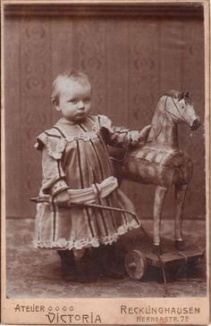 vintage photo of child with wooden horse