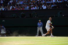 Roger Federer hits a backhand on Centre Court