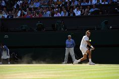 Roger Federer hits a backhand on Centre Court