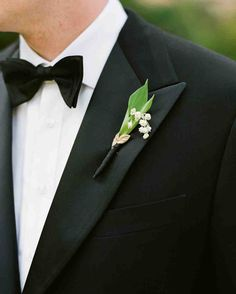 47 Boutonnieres You Both Will Love | Martha Stewart Weddings - A sprig of lily of the valley and a faux gold leaf gave this groom's lapel a special touch.