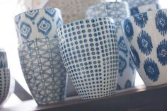 blue and white, hand stamped cups...functional and pretty when displayed on open shelving...photo by Karen Sachar
