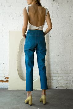 The 70's are back in a big way- raise the waist-line above the belly button but keep it modern with a slightly baggy leg.
