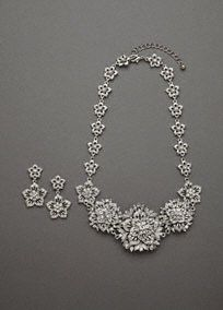Bold and beautiful is an understatement when it comes to this fabulous necklace and earring set!   Necklace and earring set features dramatic and eye-catching floral crystal design.  Available in Silver. Imported.
