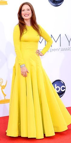 Emmys' Arrivals Gallery - Emmy Awards 2012 : People.com  ---Juilianne in yellow, stepping out of the box.
