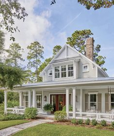 This Lowcountry farmhouse blends the best of Southern architecture.We heard our readers loud and clear—the Lowcountry Farmhouse was far and away the most-loved Southern Living house plan of This timeless home—designed by architect … Farmhouse Homes, Farmhouse Plans, Cottage Homes, Country Farmhouse, Modern Farmhouse, Low Country, Farmhouse Front, House In The Country, Farmhouse Decor