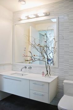 shiny porcelanosa tiles mix with matte white ames tile in the main bathroom the curly