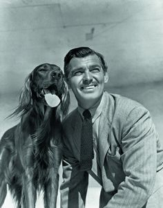 Clark Gable poses with a dog. (Eric Carpenter/MGM)