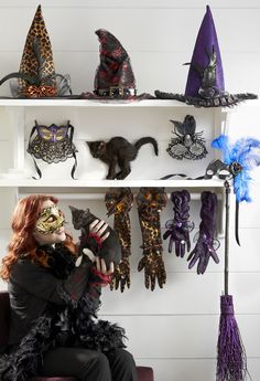A witch's closet filled with Pier 1 Witch Hats, Gloves and Venetian Masks